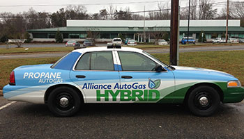 Historical Image Of Older Vehicle Wrapped In Alliance AutoGas Branding
