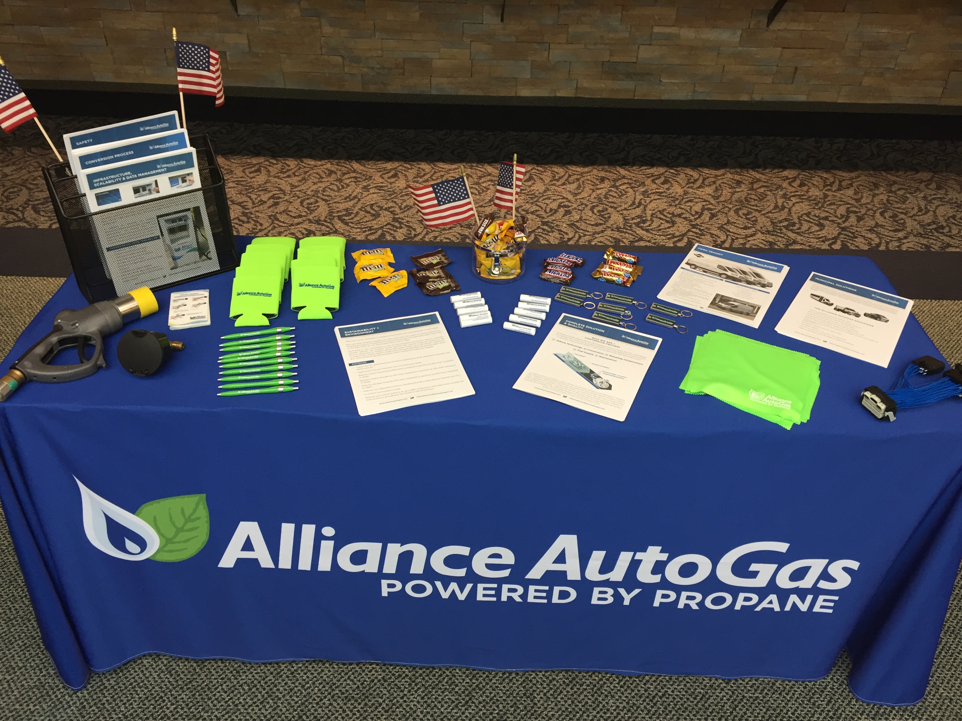 Alliance AutoGas Swag Table Set Up At Expo - Blue Table Cloth with Company Logo