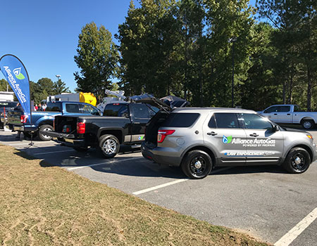 Three Alliance AutoGas Vehicles Featured in Parking Lot