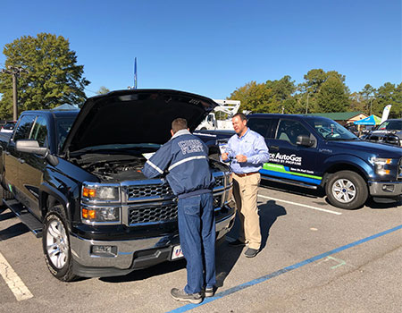 Alliance AutoGas Vehicle Ford Truck at Event with Attendees Looking Under Hood