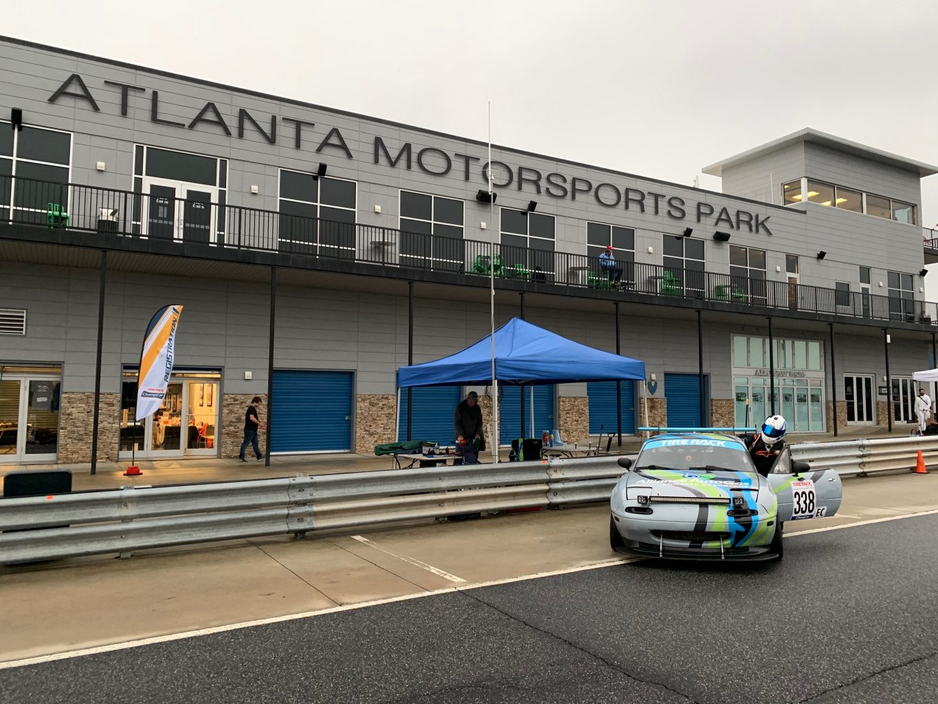 Alliance AutoGas Race Car at the Atlanta MotorSports Park with Race Car Driver entering vehicle